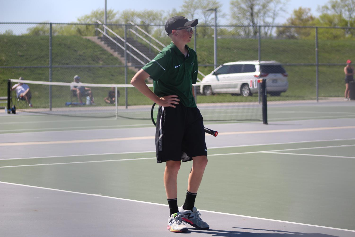 """In his singles match freshman Mason Gates plays against the Winnetonka High School Griffins on May 7 during districts. Mason is the No. 2 on varsity, and the team won the match 5-0, however Mason's match was unfinished due to the team winning. """"The only reason we won is because at the end of the day, we had more grit,"""" said Mason Gates."""